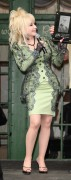 Dolly Parton.....in green.....presenting an award.....